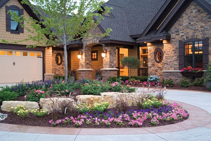 Front of home with flower bed and stones.