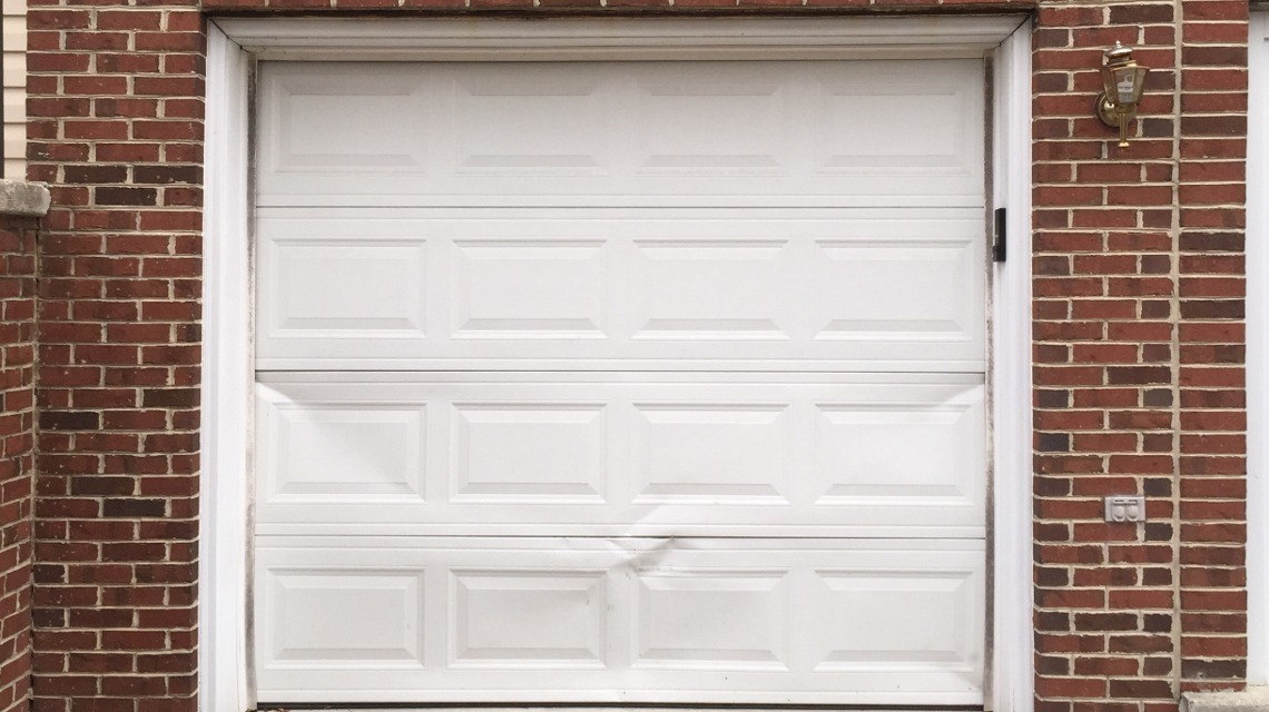 repair or replace dented garage door panel